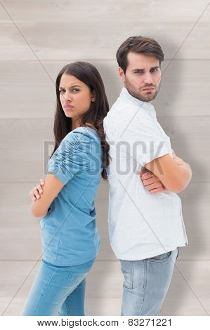 Upset couple not talking to each other after fight against wooden planks