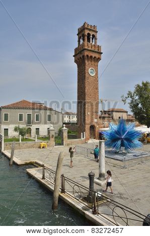 Clock Tower And A Blue Murano Glass Sculpture
