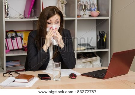The Girl Wiping Nose With A Tissue In The Office