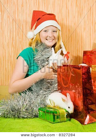Girl In New Year Decoration With Rabbits