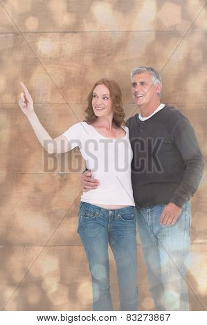 Casual couple walking and pointing against light glowing dots design pattern