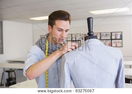 Fashion student working on mannequin at the college