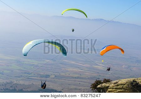 Paragliding competition above the high mountain