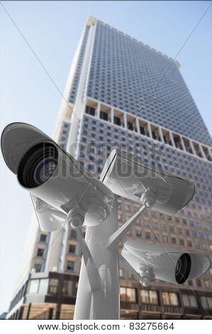 CCTV camera against skyscraper