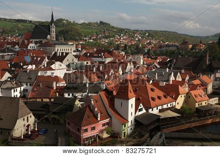 St Vitus Church over tiled roofs in Cesky Krumlov, South Bohemia, Czech Republic.