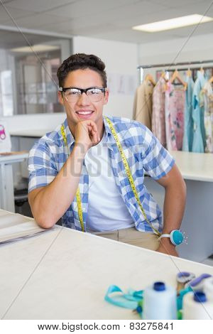 Fashion student with glasses posing at the college