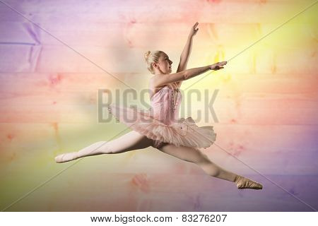 Pretty ballerina dancing against yellow and purple planks