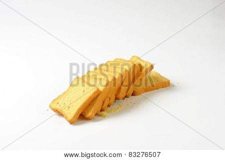 row of crispy rusks on white background