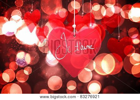 Valentines love hearts against twinkling red and orange lights