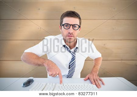 Businessman working at his desk against bleached wooden planks background