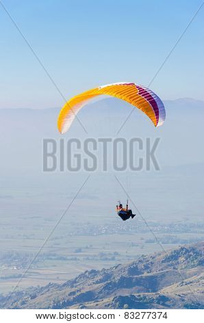 Paragliding over rocky mountains