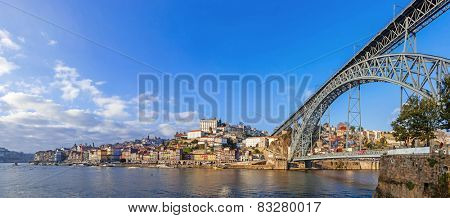 Panorama of the Ribeira District, the Douro River and iconic Dom Luis I bridge in the city of Porto, Portugal. Unesco World Heritage Site