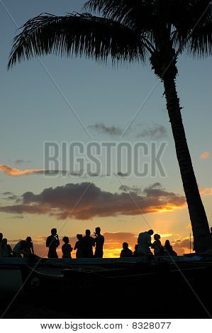 Vacation Image of Young People At A Sunset Beach Party