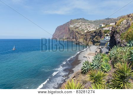 Coast Of Madeira Island With Hiigh Cliffs And Small Villages