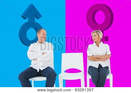 Upset couple not talking to each other after fight against pink and blue