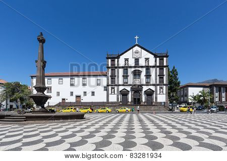 Taxis And Tourists Visiting The Central Plaza Of Funchal, Madeira Island