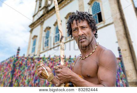 Brazilian playing Berimbau Instrument in Salvador, Bahia, Brazil