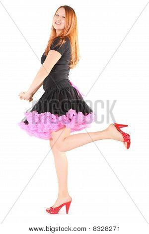 joyful woman wearing dress and shoes is posing. isolated.