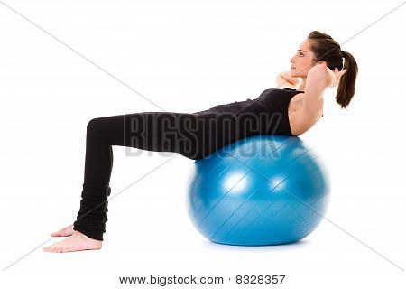 Young Attractive Female Exercise Using Blue Fitness Ball
