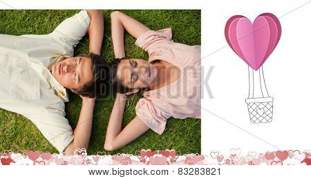 Two friends lying head to head with both hands behind their neck against heart hot air balloon