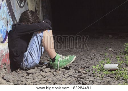 A sad teen depress at a tunnel