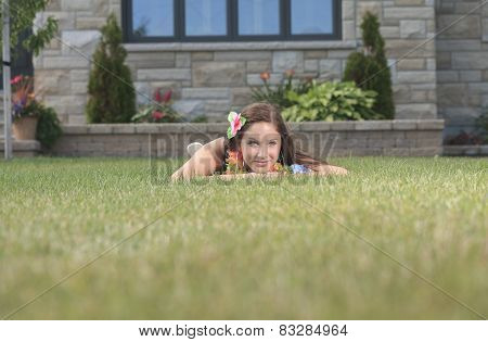 A young woman lay down and take a rest on the green grass