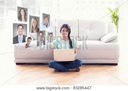 Pretty girl sitting on floor using laptop smiling at camera against profile pictures