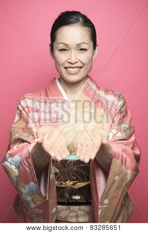 A Beautiful japanese kimono woman in pink background