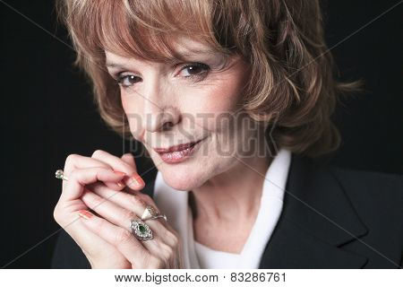 A Mature Business woman isolated on black background