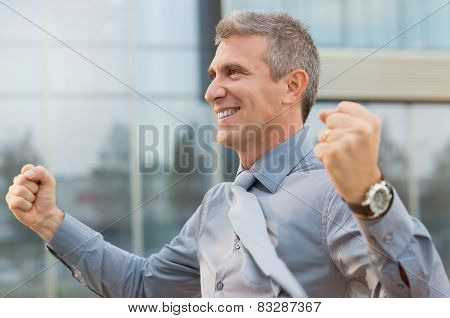 Closeup Of Exultant Businessman Clenching His Fist Outdoor