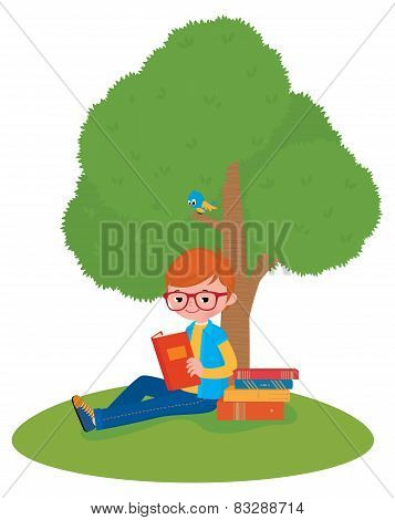 Boy Reading A Book Sitting Under A Tree