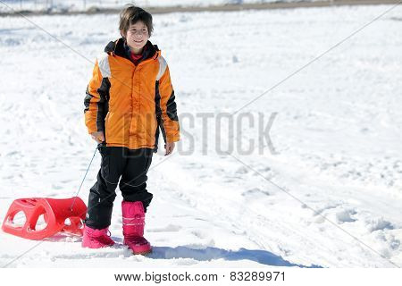 Child Plays With Bob In The Snow