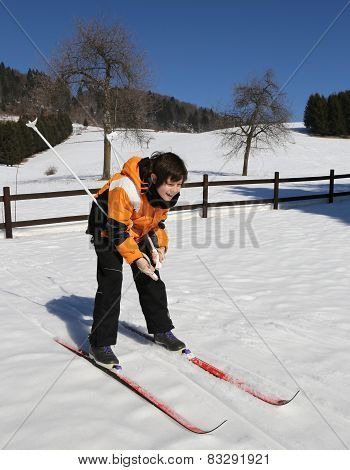 Child For The First Time With Cross-country Skiing