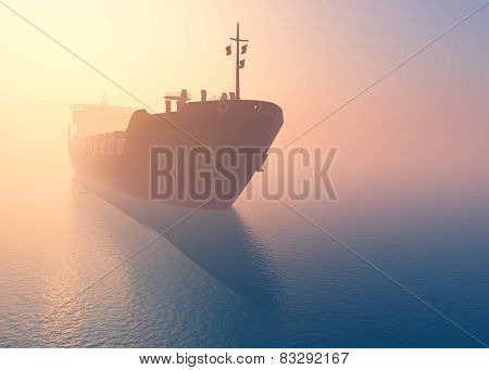 Cargo tanker at dawn in the mist.
