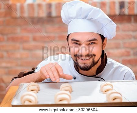Handsome cook in the kitchen