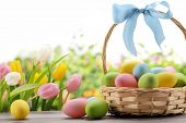 image of easter basket eggs  - Basket of easter eggs with flowers - JPG