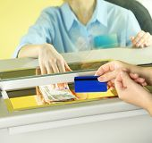 picture of cashiers  - Teller window with working cashier  - JPG