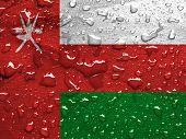 pic of oman  - a flag of Oman with rain drops - JPG