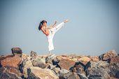 pic of karate-do  - Young girl training karate - JPG