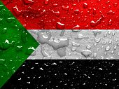 picture of sudan  - a flag of Sudan with rain drops  - JPG