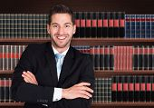 foto of lawyer  - Portrait Of Happy Male Lawyer In Front Of Book Shelf - JPG