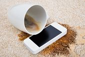 picture of carpet  - Tilt Coffee Cup Over Cellphone On Dirty Carpet - JPG