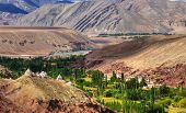 stock photo of jammu kashmir  - Rocky landscape of Ladakh with green valley in the middle Jammu and Kashmir India - JPG