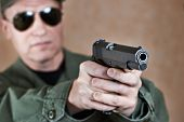 foto of pistols  - The American soldier is aiming a pistol - JPG