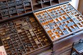 pic of armoire  - An armour with printing press letters and accessories for typesetting