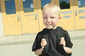 picture of playground school  - A boy on the playground of his school with a backpak - JPG