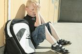 foto of playground school  - A very sad boy who was bullied on a school playground - JPG