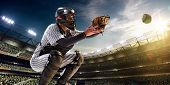 stock photo of arena  - Professional baseball player in action on grand arena - JPG
