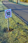 pic of mph  - 10 mph speed restriction sign on a private lane in England - JPG