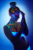 picture of uv-light  - Portrait of beautiful girl with creative body art posing in UV light - JPG